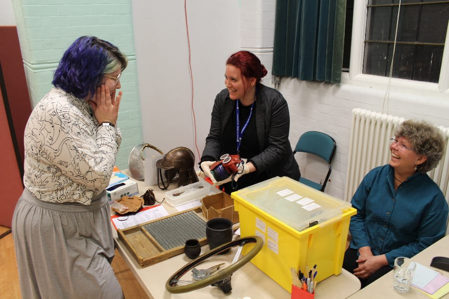 Museum volunteers check a donated item at a collecting day