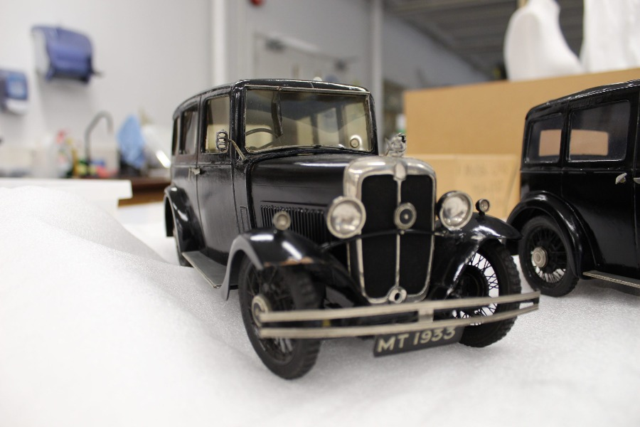 A small black Morris toy car