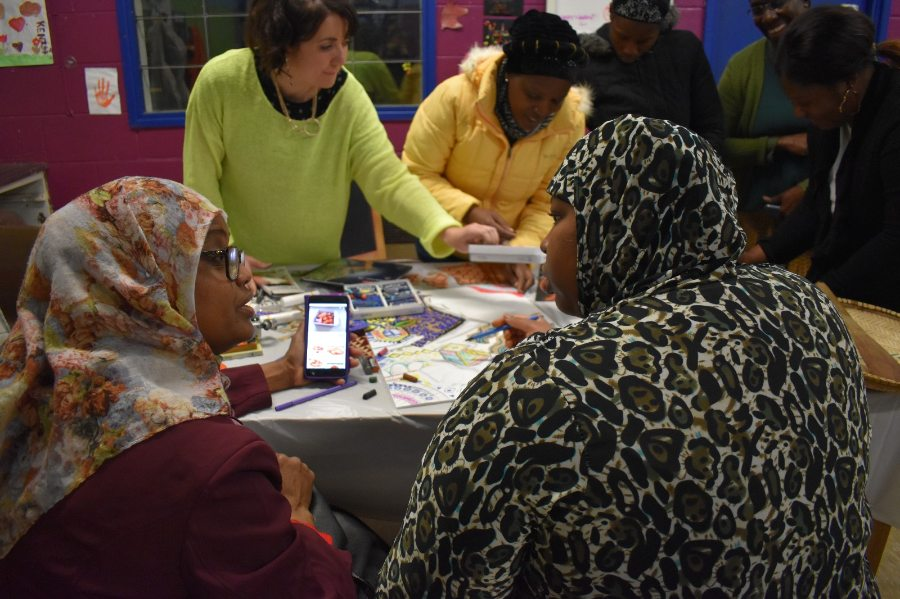 Members of the WOW SPACE group talk and create art during a Mixing Matters workshop at Blackbird Leys Adventure Playground