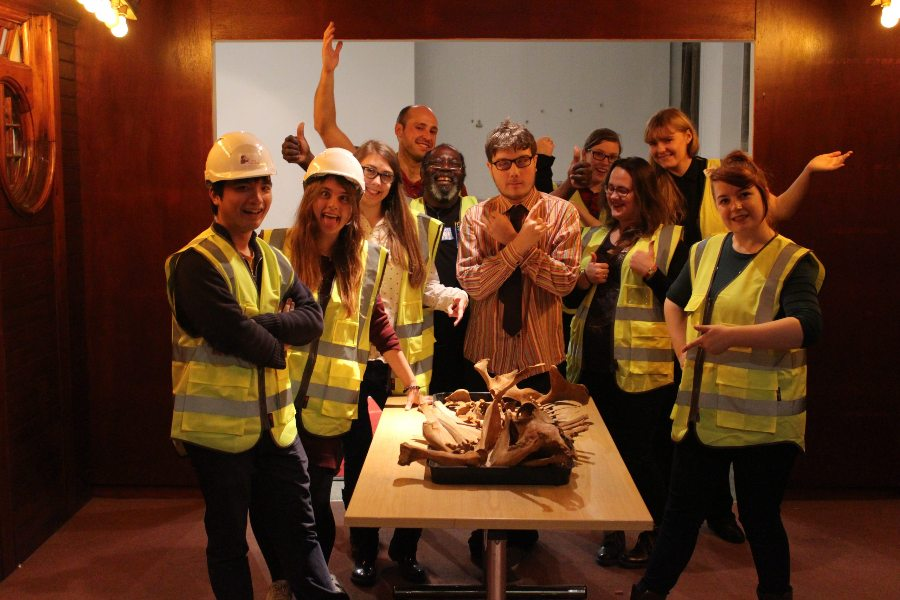 'Oxcavation' event showing a group of young people wearing high-vis and hard hats