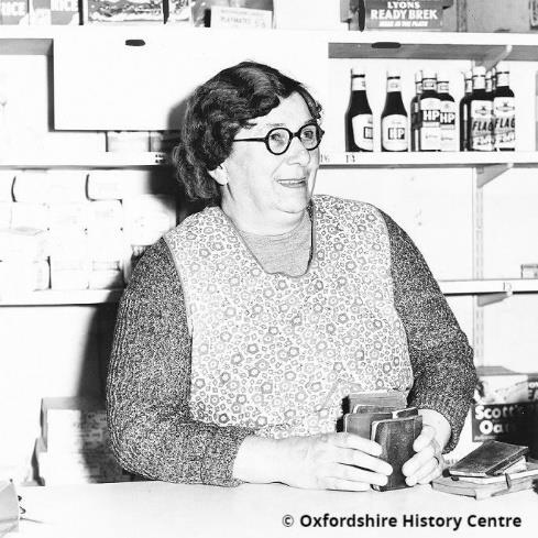 Mrs Wing behind the Post Office counter at Botley