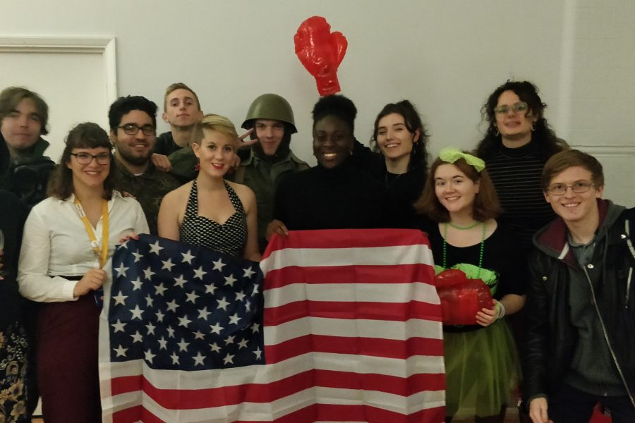 Young people holding up props relating to the Cold War