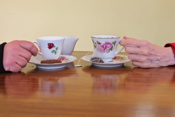 Two tea cups with hands