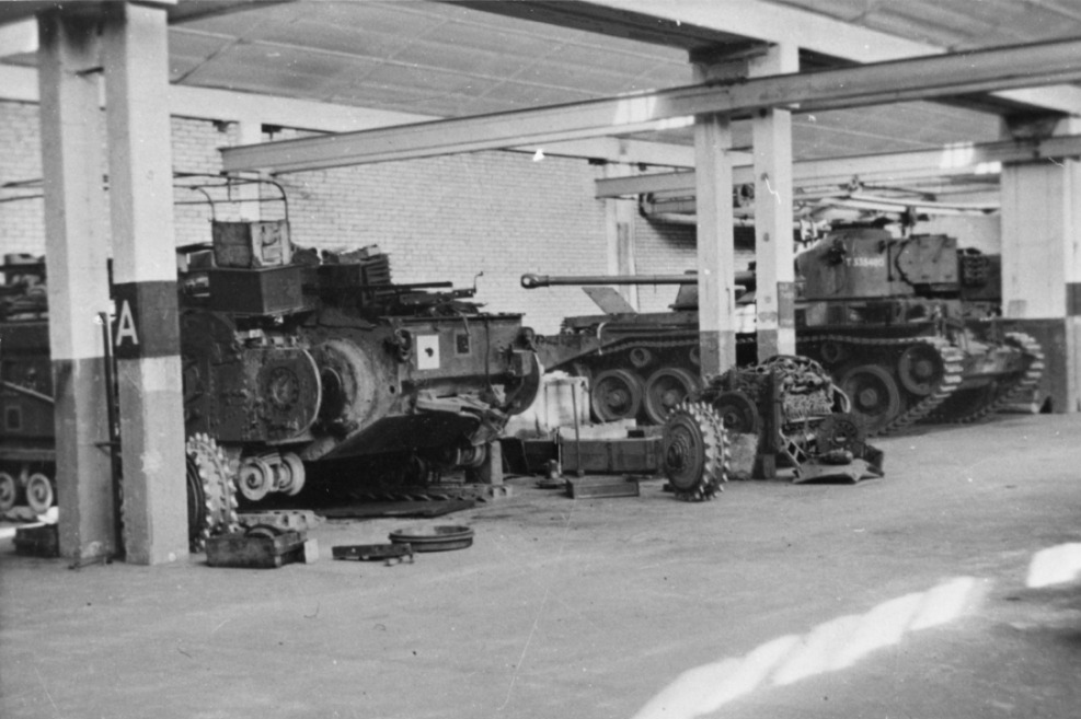 Black and white photograph of tanks in a motor factory