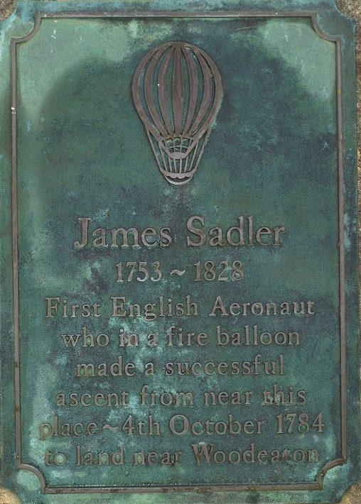Green-coloured plaque marking James Sadler's first flight