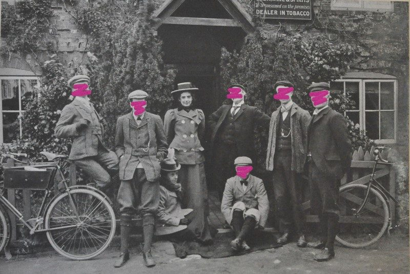 Photograph of a group of six Victorian men and two women posing outside a pub with their bicycles