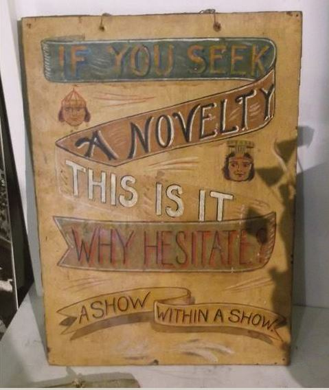 Large sign with the words ''If you seek a novelty this is it- why hesitate?'