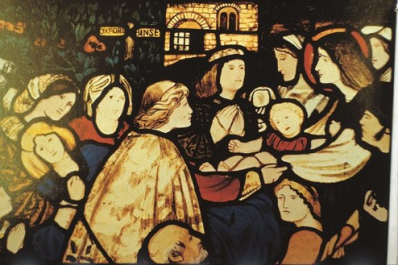Stained glass window of people surrounding St Frideswide to be healed.